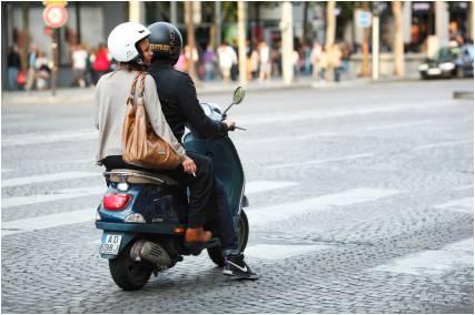 """Young """"moto"""" riders in the Champs-Élysées Paris"""